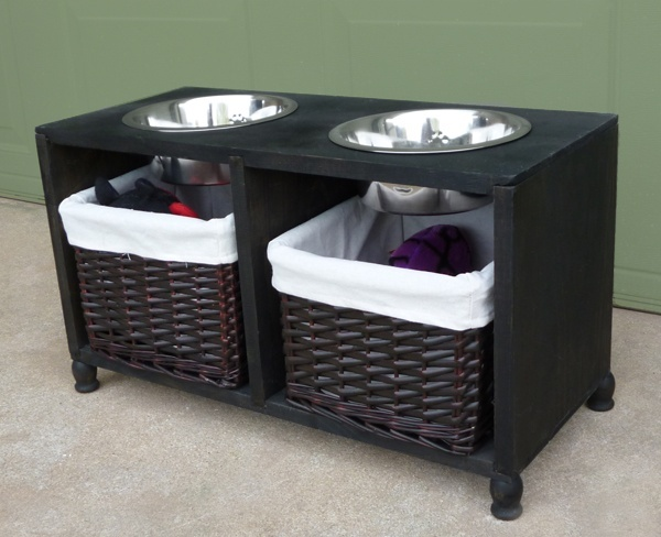 DIY: Make your dog their very own piece of furniture to hold their food and water, and store extra treats and toys.
