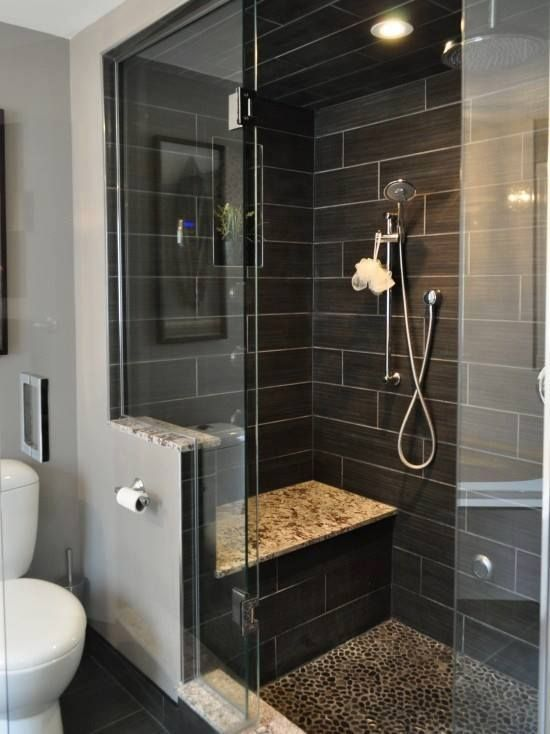 shower seat and partial wall. Marble, penny round shower floor, dark tile