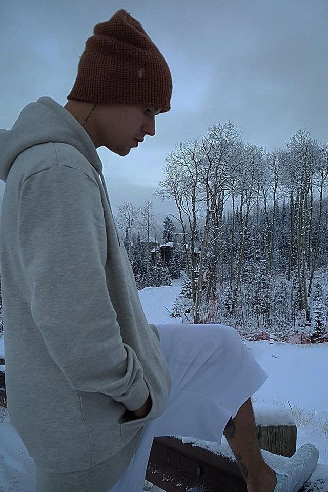 Justin Bieber wearing Yea. Nice Coffee Brown Beanie, Vans Classic Perforated Slip-On Sneaker , Drop Dead Cry Blood Hoodie