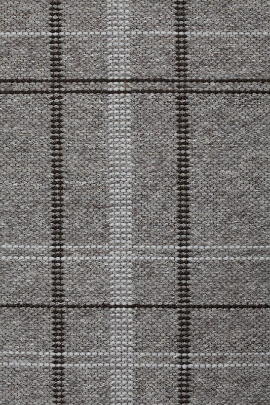 Slater in Dark Gray - Undyed Dark Gray, Thin Felted Chocolate, and Thin Felted Pumice - Customizable with all yarn colors. Slater reinterprets a classic plaid in an elegant design that will pull any room together. A flatweave rug made from undyed heathered and felted wools, Slater is available in 3 rich colorways: Natural, Dark Gray and Oxblood. Samuel Slater launched the American textile revolution when he opened the nation's first textile mill on the Blackstone River in 1792.