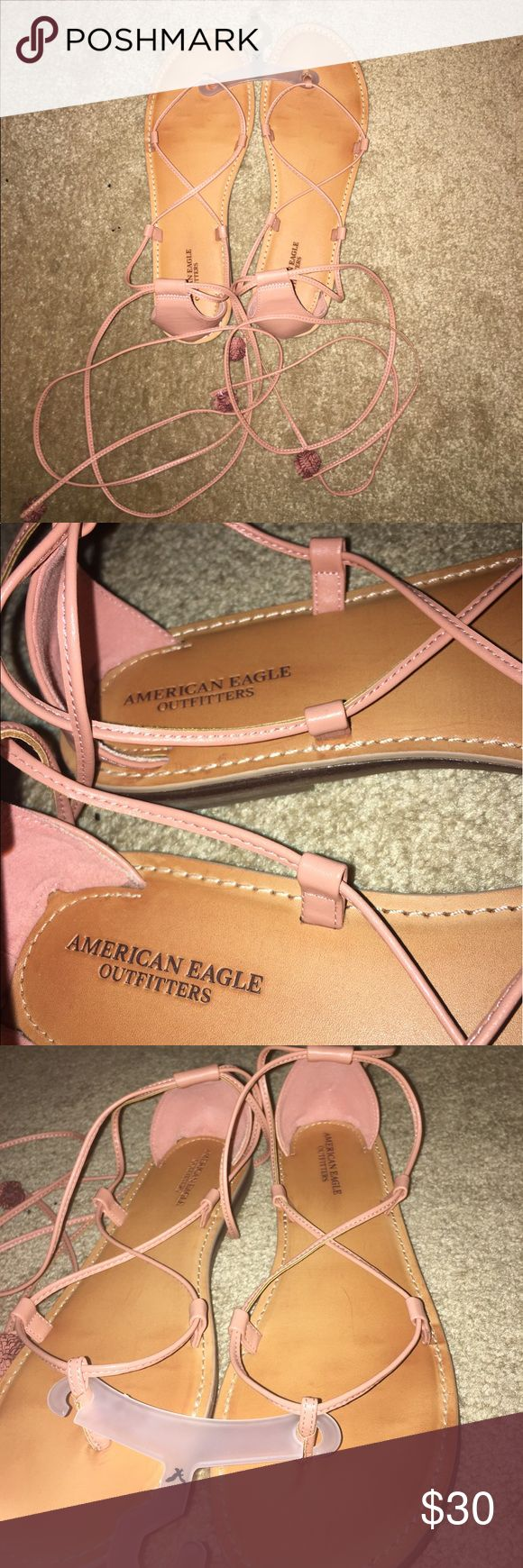 NEW!! Pink wrap around strappy AEO sandals!!! Worn once around for a few hours inside then decided they didn't look good on me so I'm selling them! Took tag off, but still has hanger which says 9/10 and size labels on bottom that say size 10 . They are very very cute! They work/fit better on a slimmer foot, but I'm sure anyone could make them work. They lace through the sides and wrap around your ankle, then you tie them to secure them. If you have any questions just let me know!! Lace up…