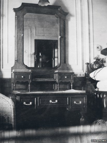 "This photo shows the interior of Father Browne's cabin. According to Father O'Donnell: ""When Ballard found the Titanic, he discovered that it was in two pieces, nearly half a mile apart. The ship split in two right through Father Browne's suite of rooms. He was 37a. The matching room on the other side of the grand staircase was inhabited by Thomas Andrews, the builder of Titanic from Harland and Wolf."""