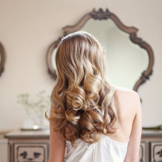 Learn how to create beautiful bouncy curls and romantic waves with this step by step tutorial