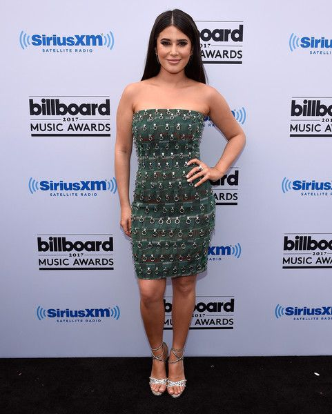 """SiriusXM host SymonÊposes at SiriusXM's """"Hits 1 in Hollywood"""" red carpet broadcast on SiriusXM's SiriusXM Hits 1 channel before the Billboard Music Awards at the T-Mobile Arena on May 21, 2017 in Las Vegas, Nevada."""