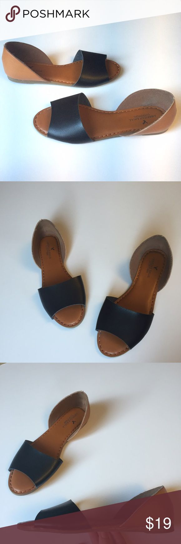 American Eagle Black and Tan open toe flats American Eagle Outfitters open toe flats in black and tan synthetic leather. Tan d'orsay heel with black toe strap. Size 10 in excellent condition. American Eagle Outfitters Shoes Flats & Loafers