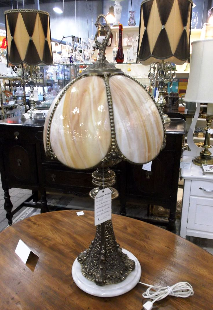 This stained glass lamp shade with marble base can is for sale for $149.00 in booth P108.  1400 Squires Beach Road, Pickering, ON L1W 4B9. 905) 427-7902. www.roadshowantiquespickering.com