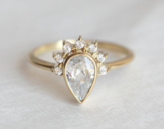 0.75 carat pear shape diamond ring. So feminine and elegant! 18K gold diamond prong engagement ring with beautiful sparkly pear cut diamond. Ring comes