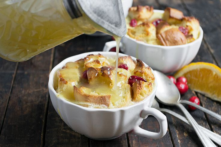Comforting and creamy bread pudding, flavoured with fresh cranberries and orange marmalade and topped with a warm Butter Sauce.