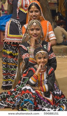 Group of Kalbelia tribal dancers performing at the annual Sarujkund Fair near Delhi, India