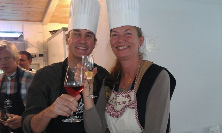 Our guests enjoying a glass or two after a cooking course. Learn how to make food with our talented chefs. Hotel Refsnes Gods