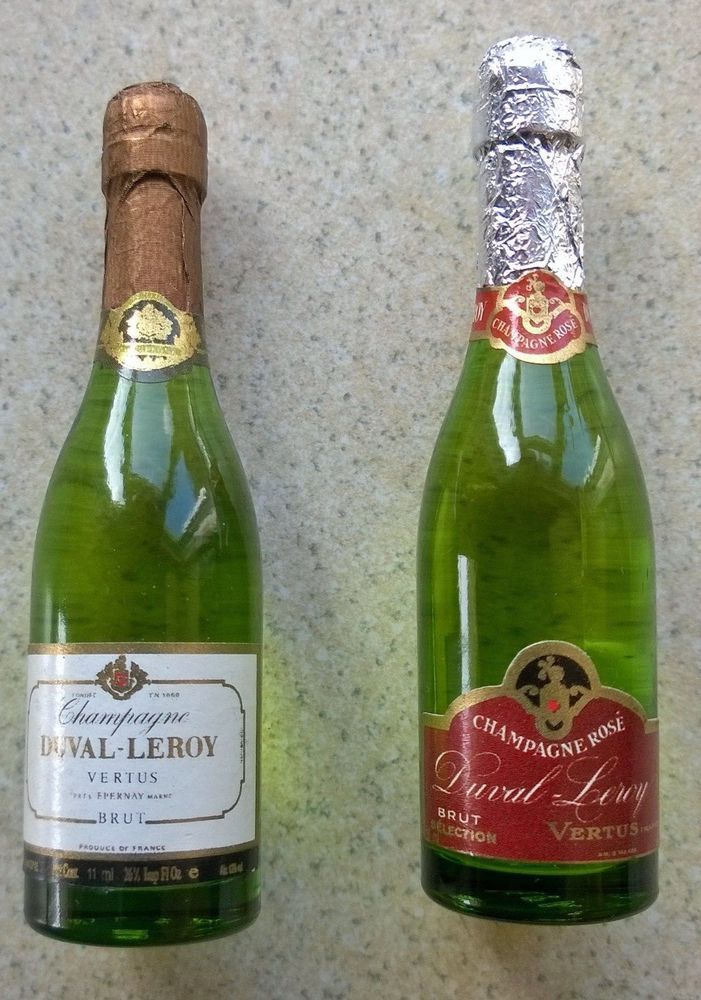 Two minature / toy DUVAL LEROY champagne bottles