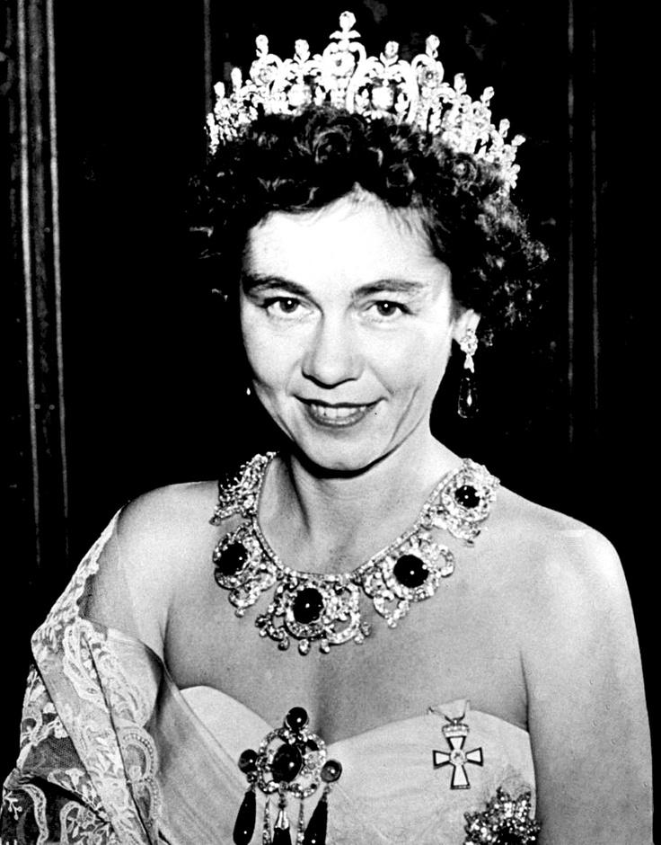 Queen Friedrika of Greece, wearing not one, but two tiaras! Queen Sophia's Diamond Tiara as a tiara and the Emerald Parure Tiara as a necklace.