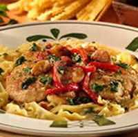 Olive Garden Tuscan Garlic Chicken~ 4 chicken breasts 1 1/2 cups flour 1 Tbsp salt 2 tsp black pepper 2 tsp Italian seasoning 1 lb fettuccine pasta 5 Tbsp olive oil 1 Tbsp garlic 1 red pepper 1/2 cup white wine 1/2 lb whole leaf spinach 2 cups heavy cream 1 cups Parmesan cheese
