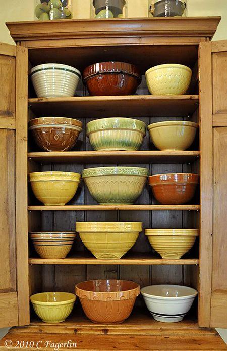 Cabinet full of vintage mixing bowls, via the Living Vintage blog.