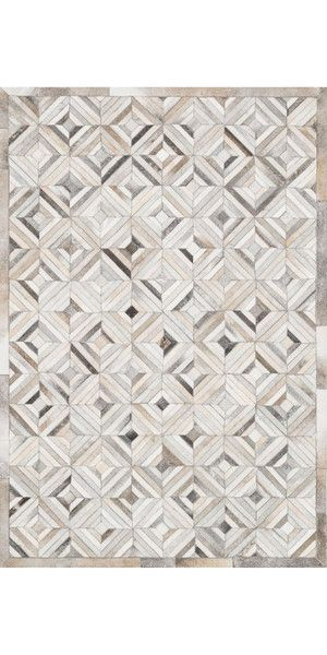 Hand-knotted in India of a jute base and wool pile this rug offers a subdued tribal feel with geometric motifs. The textural highs and lows loosely echo the stone paths and architecture of the old world countries Hemingway frequented.