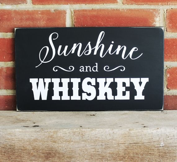 Sunshine and Whiskey    Great Southern saying on an 8x14 inchpainted worn finish wood sign.