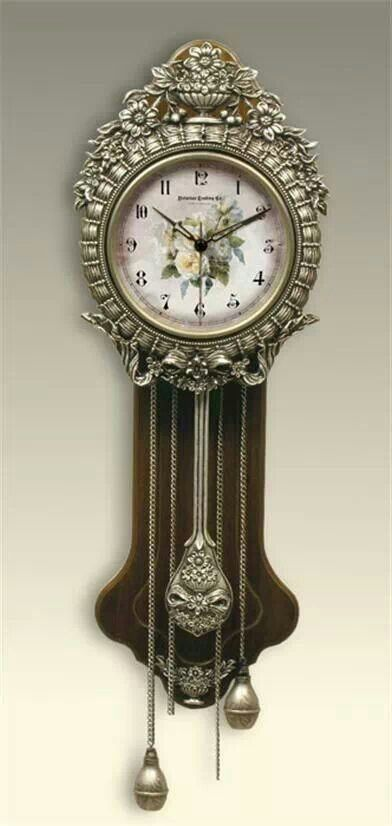 Love this vintage grand father clock,with beautiful roses on it's face.