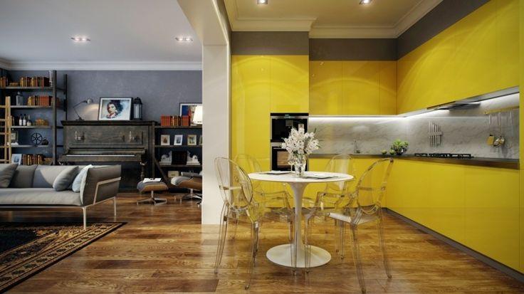décoration de cuisine avec table ronde et des chaises transparentes