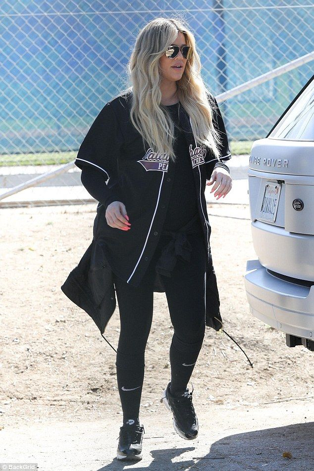 Can't play: heavily pregnant Khloe Kardashian had to watch from the dugout as her family participated in a softball game on Thursday
