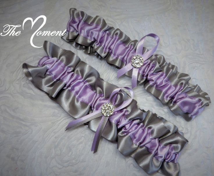 Beautiful Keepsake garter as well as a Toss-away garter in silver and Lavender Satin accented with a sparkling rhinestone brooch. These garters are made from quality fabric and ribbons. Relaxed these