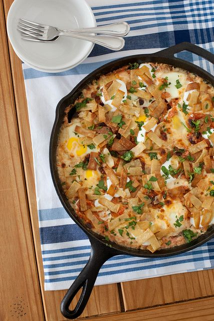 baked ranchero eggs with blistered pepper jack cheese by annieseats, via Flickr