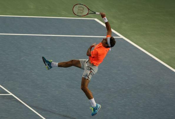 Roger Federer, Dubai 2015 - those shorts!, love that he's rocking Rafa's kit! - ESPN Photo Wire - ESPN (AP Photo/Kamran Jebreili) #RogerFederer #Federer #FedExpress #tennis