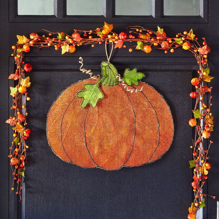 There's something warm and welcoming about burlap. Even more so when you use it to craft a festive pumpkin door hanger. Take a peek at Michael's tutorial for this piece of DIY home décor.