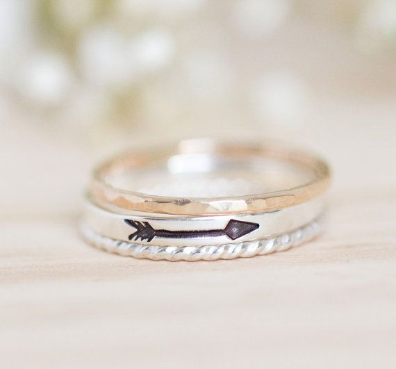 This arrow stacking ring is made out of 2mm wide sterling silver wire and stamped with an arrow. You can also make this a personalized ring