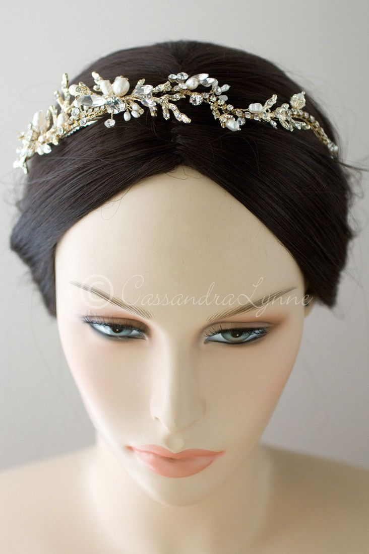 For the beach going bride this wedding headpiece is designed with crystal dotted coral branches, marquise crystals and sprays of freshwater pearls. It could be