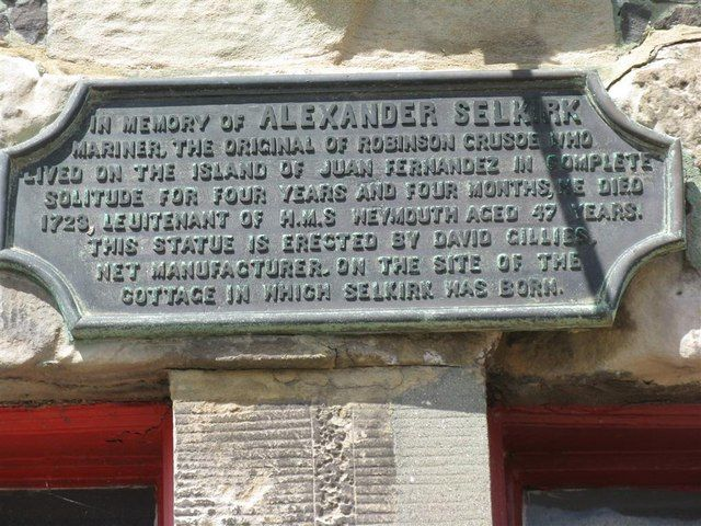 Plaque in memory of Alexander Selkirk by M J Richardson. Plaque in memory of Alexander Selkirk  Selkirk was born on a cottage on this site and is thought to have been the inspiration for Daniel Defoe's 'Robinson Crusoe'. Note the mis-spelling of 'Lieutenant'.