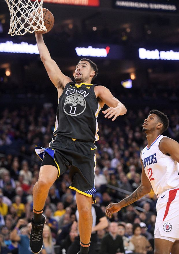 Golden State Warriors' Klay Thompson (11) gets past Los Angeles Clippers' Tyrone Wallace (12) for a basket in the second period of their NBA game at Oracle Arena in Oakland, Calif., on Thursday, Feb. 22, 2018. (Doug Duran/Bay Area News Group)