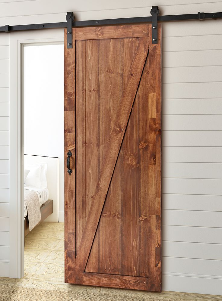 Perfect for any opening, this Rustic Sliding Barn Door Kit provides an interesting and elegant transition between spaces, in true rustic style, this door-mount hardware features a Matte Black Finish to provide a down-home feel.