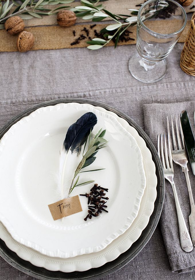Feather and herb place setting.
