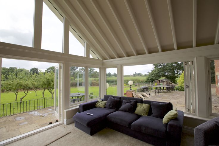 Our bifolding doors and bifolding windows open out this room into the garden beautifully.
