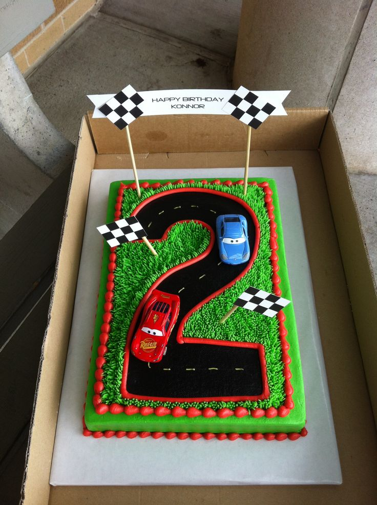 """Notes to self: Checkered sugar sheet around edge; cardboard cutout to trace fondant """"2"""" (or outline on cake, fill with icing); race flags; hotwheels. Race check cupcake wrappers."""