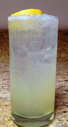 "Nothing says ""summer"" quite like fresh squeezed lemonade from the backyard tree. Even better is this Lemon Vodka Refresher. Lemon Vodka Refresher Ingredients 1 ounce Kettle One Citroen vodka 1/2 ounce fresh squeezed lemon juice 1 ounce home made simple syrup Sprite Preparation Fill a Double"