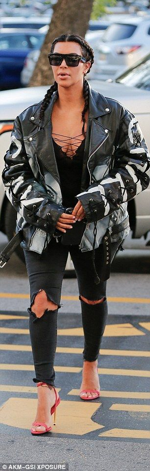 Her favorite! Kim Kardashian wears custom leather jacket with her  face on it as she and Kanye West head to the movies | Daily Mail Online
