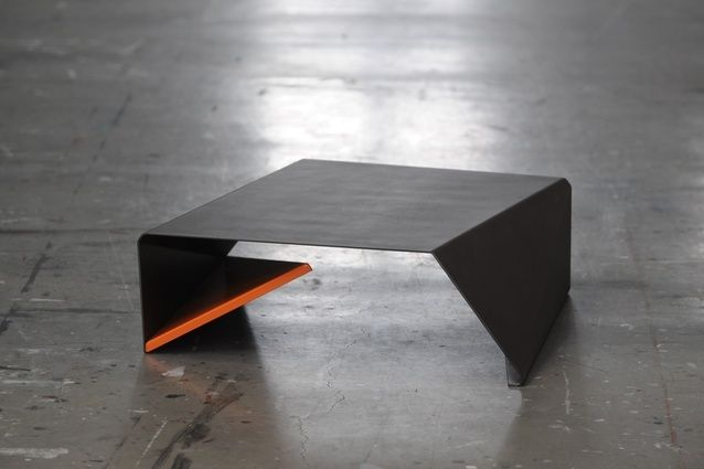 Stealth table, in folded steel plate, explores the twisting of forms.