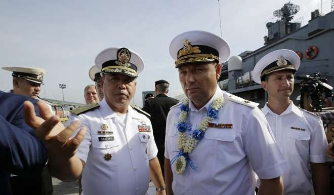 Philippine Navy Commander Naval Combat Engineering Brigadier Francisco Gabudao Jnr (left) with Russian Rear Admiral Eduard Mikhailov, Deputy Commander of Flotilla of Pacific Fleet of Russia at Manila's pier on January 3, 2017. Photo: AP