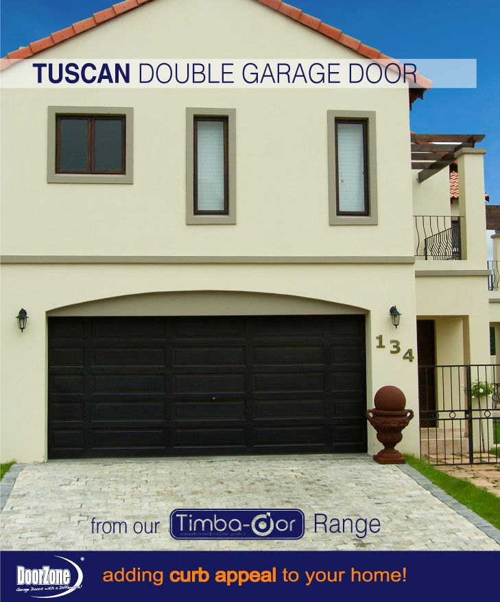 A simple impact! Black Tuscan Style double Garage Door from our Timba-dor™. www.doorzonesa.com