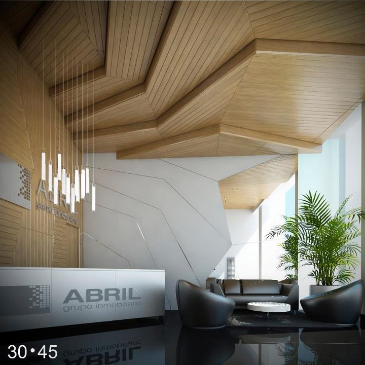 Simple white reception desk to compliment wood panelling The Abril Grupo…