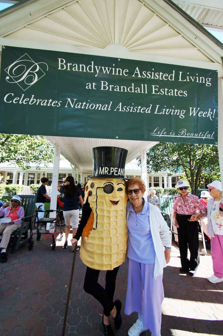 Resident from our Brandall Estates Community posing with Mr. Peanut!