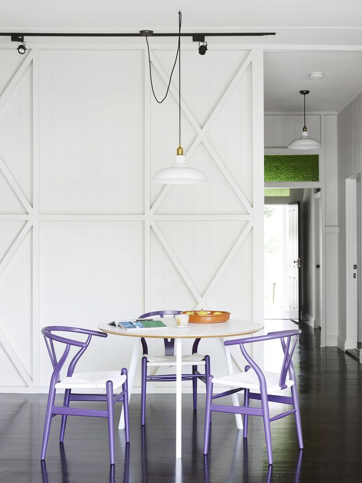 Georgia Cannon // M2 House // white; black; track lighting; dining pendant; Hay Loop table; Carl Hansen + Son purple CH24 wishbone chairs; green glass; framed wall // Photographer: Toby Scott http://cimmermann.co.uk/blog/dining-tables-favourites/