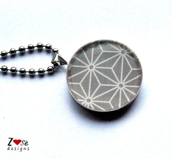 Grey resin #pendant with geometric flowers. by ZoseDesigns