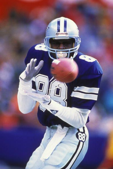 Michael Irvin of the Dallas Cowboys makes a catch during a NFL football game against the Philadelphia Eagles on December 23 1990 at Veterans Stadium...