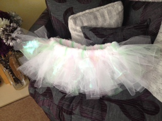 No sew Tutu using a wide piece of elastic, strips of white, lime & rose dress net and iridescent organza.
