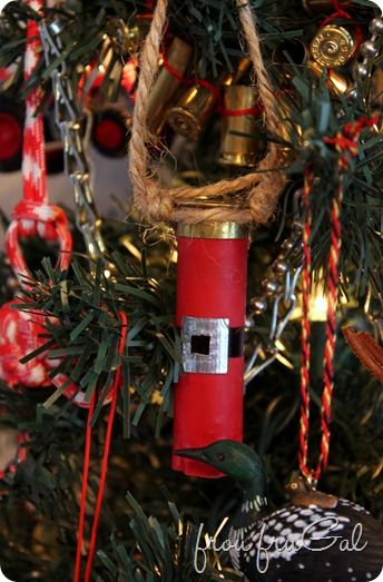 Shotgun Shell Santa Suit Ornament: Clean the shells with a Magic Eraser, Draw the belt on with a Sharpie and use silver Duck Tape for the buckle.
