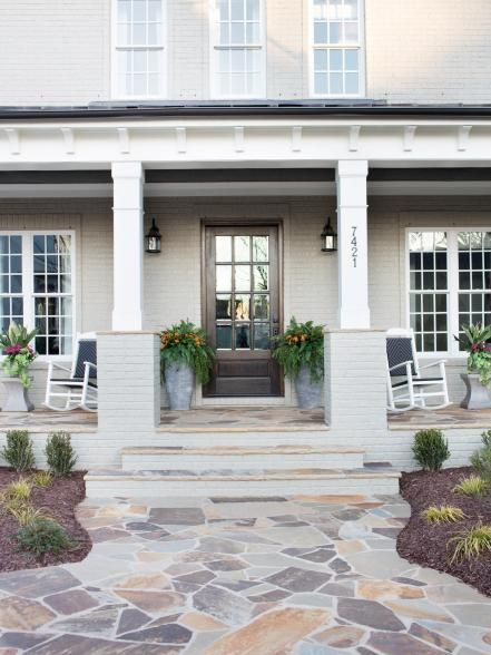 Craftsman architecture, manicured landscaping, and a subtle exterior color palette comprise this inviting exterior in North Carolina.