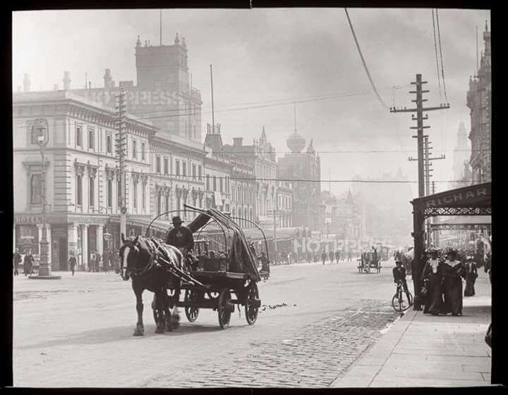 Horse and cart make their way down Bourke St having just crossed Russell St in Melbourne in 1900.