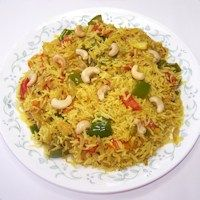 Bell Pepper And Tomato Rice Recipe from Givoli.com